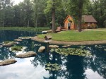 Front of cabin with hot tub in summer